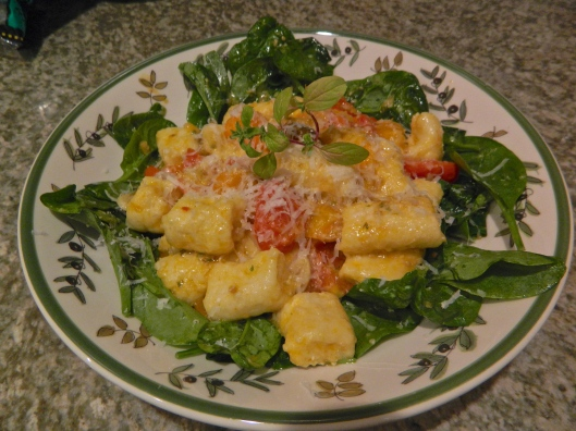 Butternut gnocchi hugging greens.