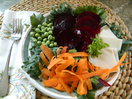 My salade compose. The darker beets on the left were marinated in red balsamic vinegar and the beets on the right drank the white balsamic with a dash of pomegranate vinegar. The peas are freshly harvested and so tender, I decided not to cook them.