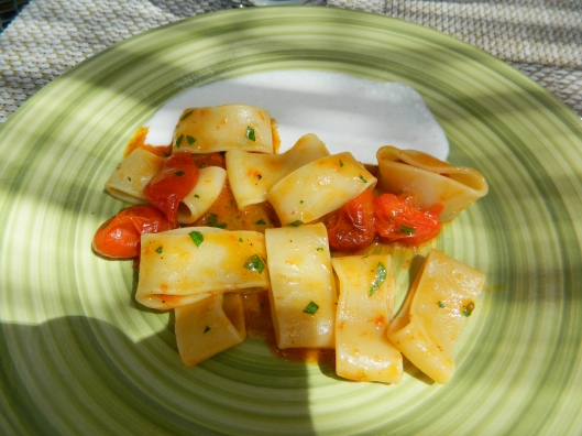 "Pasta called ""calamarata"" probably because it looks like little calamari rings. Served with a fondue of pecorino."