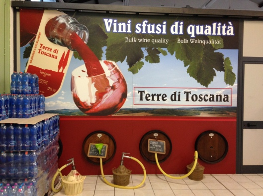 "Wine dispensary housed in a small vegetable market in Lucca. The painting says ""Try it. You'll like it!"""