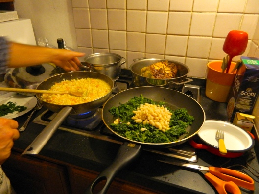Nicola artfully balances four burners full of food all going at once: The Faraona, rutabagas, pumpkin risotto, chopped greens with white beans.