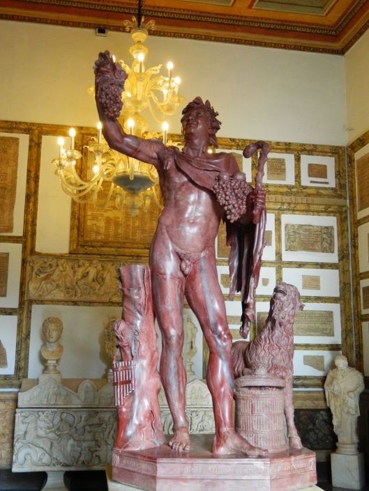 The Red Faun, a satyr and follower of Dionysus, the god of wine made of striking red marble.
