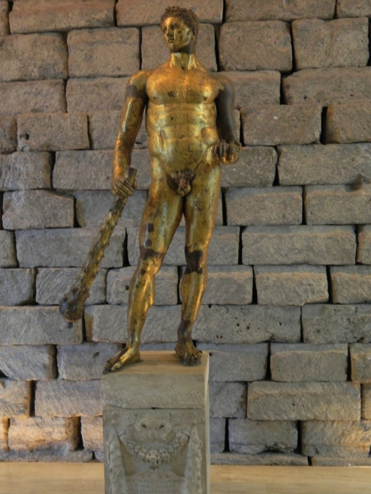 The Golden Boy Hercules in guilded bronze circa second century B.C. The stone background seems to emphasize his masculinity and strength.