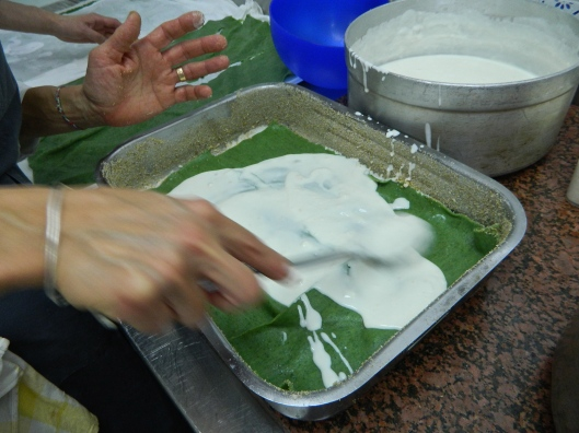 Bechamel sauce tops the spinach lasagne as the first layer.