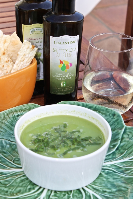 Warm or cold soup topped with shredded mint and served with a glass of cold Pinot Grigio. It is delicious with a splash of lemon or herb olive oil!
