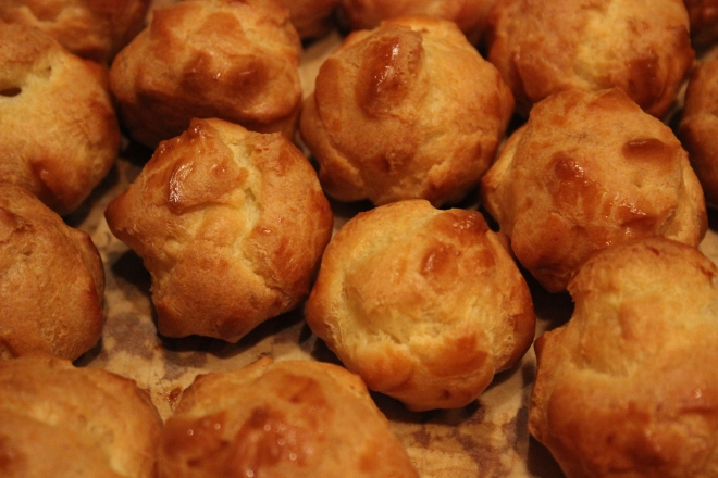 The baked puffs, golden and ready to be filled with pastry cream.