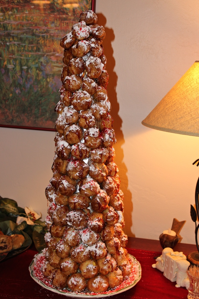 Le Croquembouche. A cream puff tree glazed with spun sugar and snow-capped with powdered sugar. It is as delicious as it is beautiful.