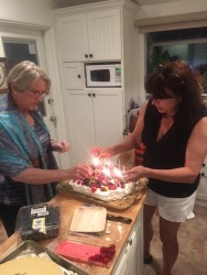 Barb and Ali lighting the candles.